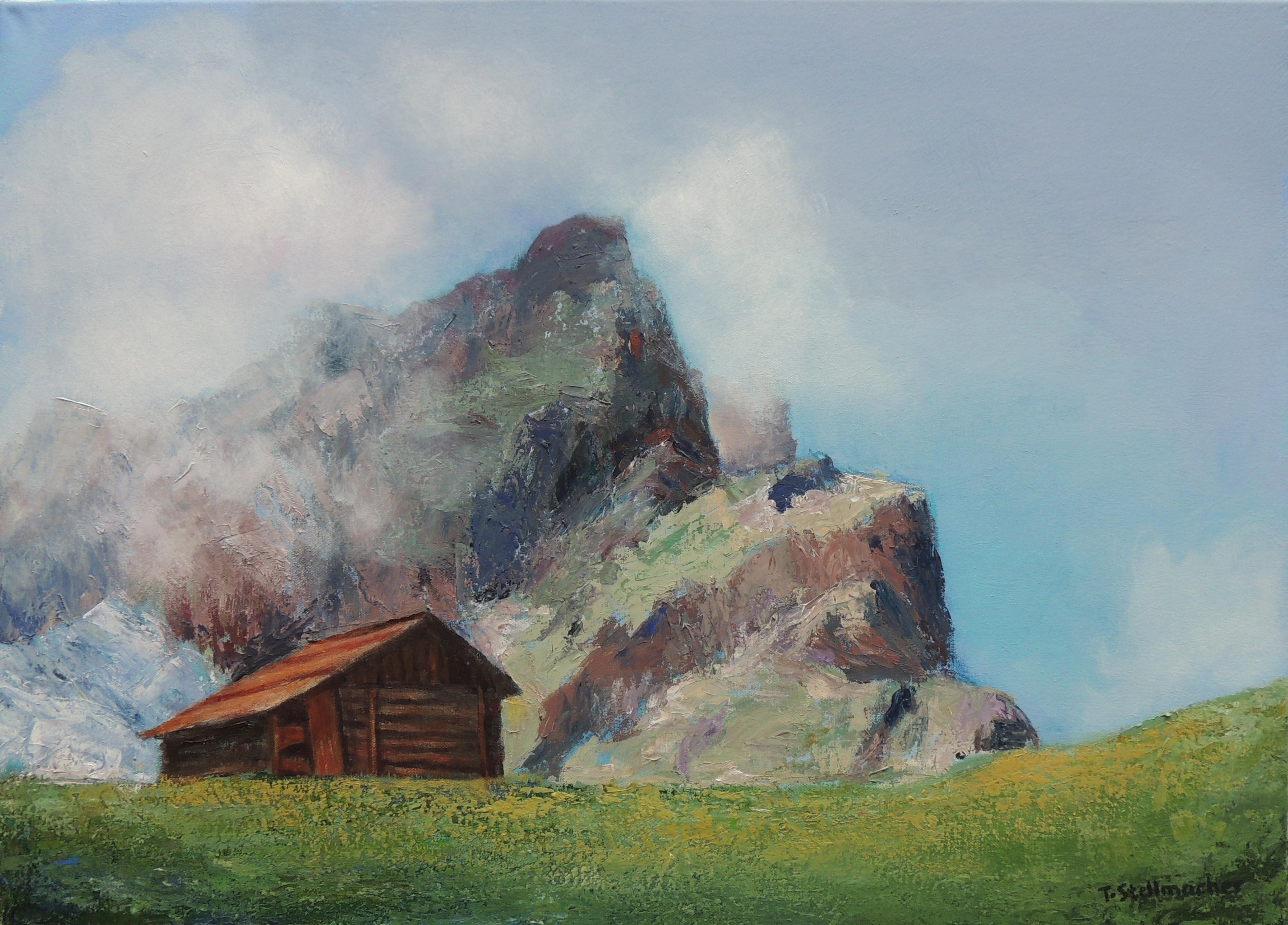 Berghütte im Campilltal, dahinter Geislerspitzen